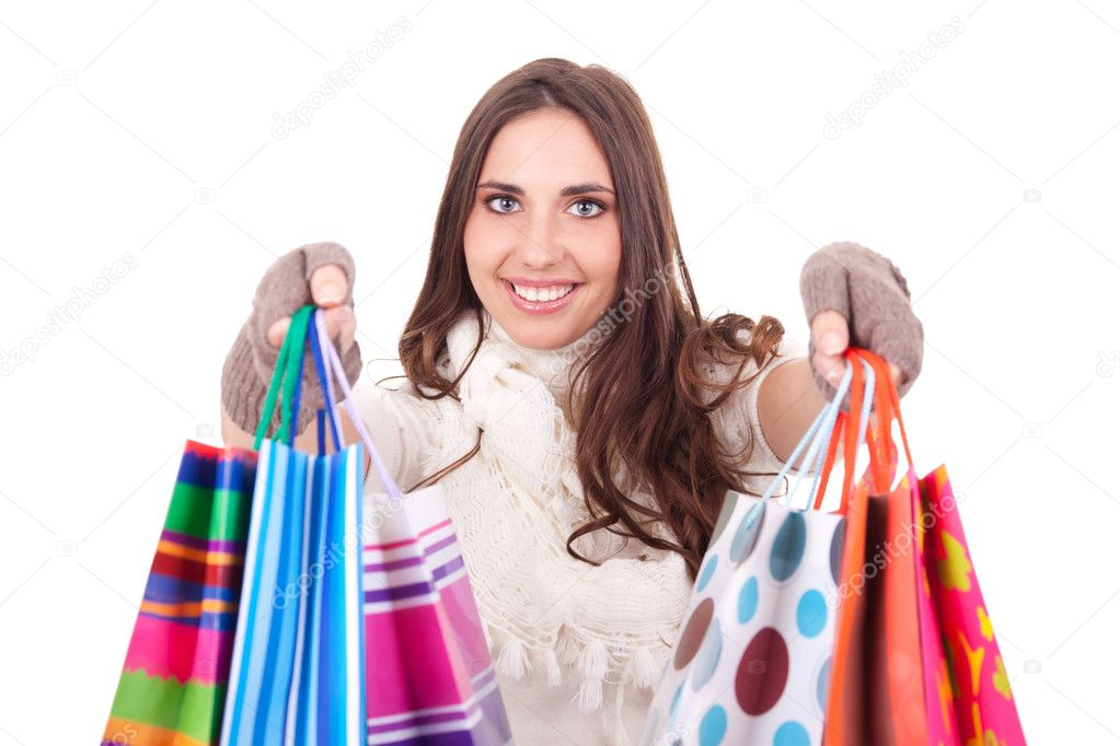 Lovely woman shoving her shopping bags, isolated on white background — Stock Photo #6916376