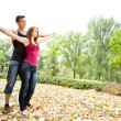 Couple with outstretched arms — Stock Photo