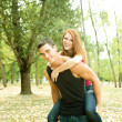 Couple playing piggyback — Stock Photo