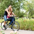 Couple on bike - Stock Photo