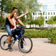 Stock Photo: Couple riding a bicycle