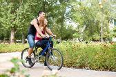 Couple on bike — Foto de Stock