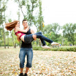 Happy couple having fun in park — Stock Photo