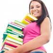 Girl with  big stack of books — Stock Photo
