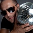Handsome man with disco ball - Stock Photo