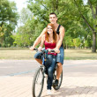 Happy couple riding on a bicycle — Stock Photo #7300729