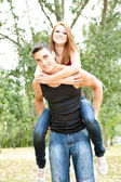 Young couple playing piggyback — Stock Photo