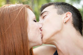 Young couple kissing, — Stock Photo