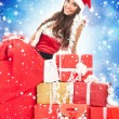 Christmas girl with gifts — Stock Photo