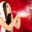 Santa girl blowing snow — Stock Photo #7363423