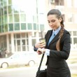 Busy businesswoman checking the time — 图库照片