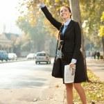Woman hailing taxi — Stock Photo #7363606