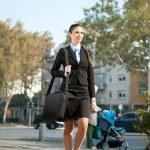 Businesswoman going on work — Stock Photo #7363612