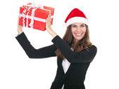 Santa bizneswoman gospodarstwa prezent — Zdjęcie stockowe