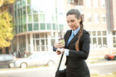 Busy businesswoman checking the time — Stock Photo