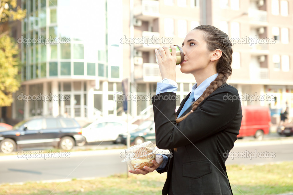 Businesswoman breakfast on the way to work, overworked — Stock Photo #7363590
