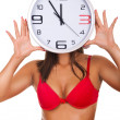 Naked woman holding clock on face — Stock Photo