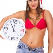 Santa girl in underwear holding clock — Stock Photo