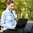 Businesswoman with laptop outside — Stock Photo