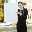 Businesswoman pointing in blank paper — Stock Photo
