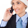 Businesswoman in santa hat talks on the phone. — Stock Photo #7479736