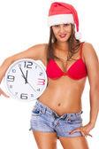 Santa girl in underwear holding clock — Stock Photo