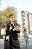 Businesswoman going to work with breakfast — Stock Photo