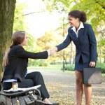 Two businesswomen handshaking — Stock Photo