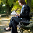 Businesswoman outdoor reading newspaper — Stock Photo