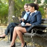 Businesswomen working in park — Stock Photo