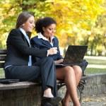 Two businesswomen working, outdoor — Stock Photo