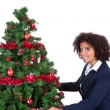 Afro woman decorating christmas tree — Stock Photo