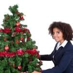 Afro woman decorating christmas tree — Stock Photo