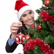 Smiling woman with christmas ball - Photo