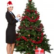 Girl decorating christmas tree - Photo