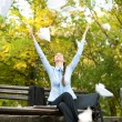 Businesswoman throwing paper in the air — Stock Photo #7585788
