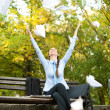 Businesswoman throwing paper in the air — Stock Photo