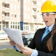 Engineer reading paperwork — Stock Photo #7585829