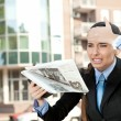 Woman reading newspaper, oh no bad news ! — Stock Photo #7585836