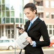 Businesswoman using mobile phone — Stock Photo