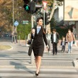Businesswoman walking on street — Stock Photo