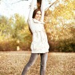 Autumn woman outstretching — Stock Photo #7585948