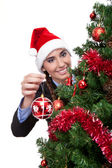 Smiling woman with christmas ball — Stock Photo