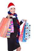 Christmas girl with shopping bags — Stock fotografie