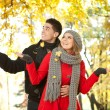 Stock Photo: Couple in falling leaves, love in autumn park