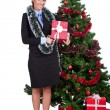Woman with gift near christmas tree — Stock Photo #7801222