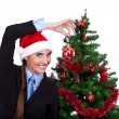 Funny woman decorating christmas tree — Stock Photo #7801223