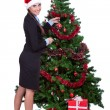 Royalty-Free Stock Photo: Woman arranging  christmas tree