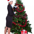 Woman arranging christmas tree — Stock Photo #7801230