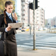 Serious businesswoman reading newspaper — Stock Photo #7801418